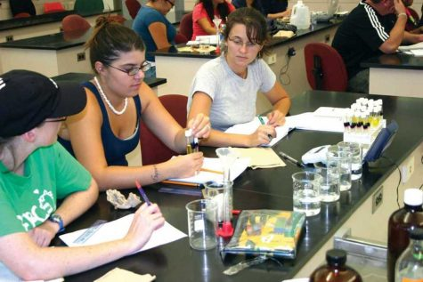 Sally Smith, left, Jerrica Huling, center, and Jennifer Foster work on a diffusion experiment in Biology class at Oxnard College. OC received a $2.5 million grant for Science, Technology, Engineering, and Math.