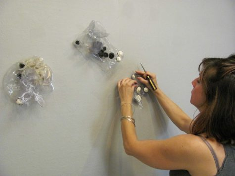 Lana Shuttleworth setting up her art work in the Moorpark College Art Gallery.