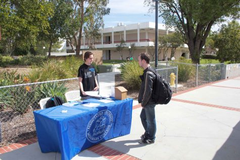 Andrew Anderson, left, helps student like Ethan Lieberman realize how they can become more involved in their school through his promotion of the Associated Students elections.