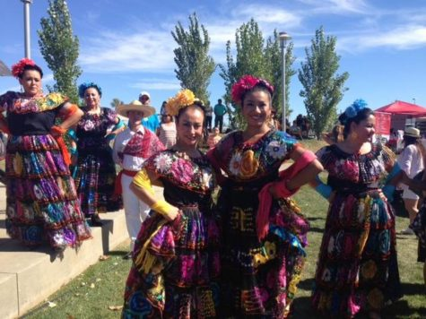 Two members of the Mestizo dance group pose for a quick picture before their performance. Photo credit: Daniela Alvarez