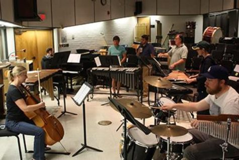 Members of the percussion ensemble rehearse for their upcoming show. Photo credit: Amanda Galvez