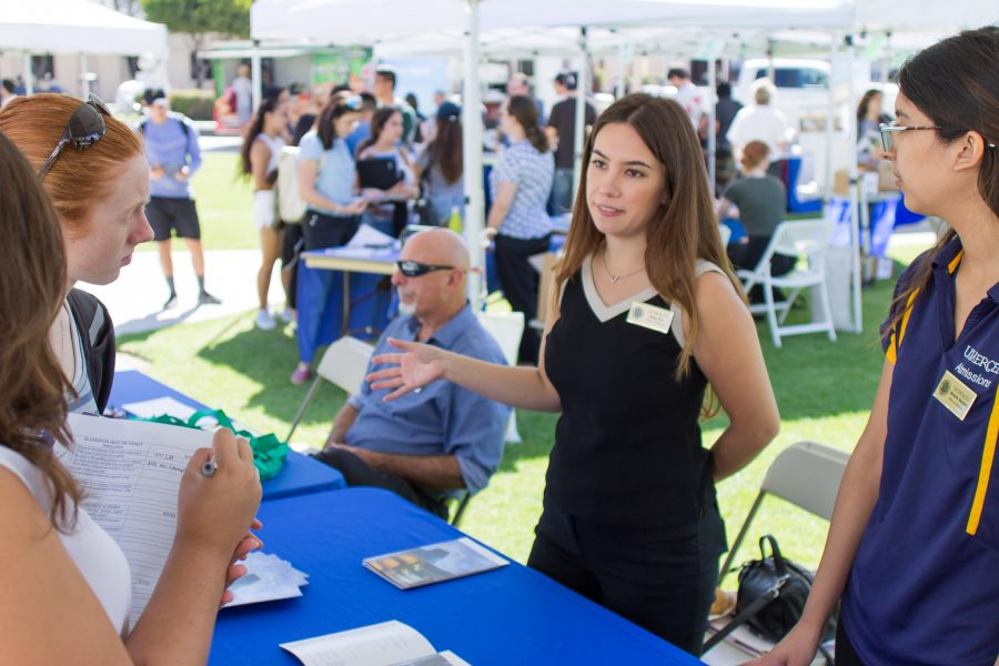Megan Wolfe, 18-year-old global studies major, and Hannah Miller, 18-year-old kinesiology major, listen intently as Iona Nee and Michelle Martinez of University of California Merced offer information about transfer; Moorpark College, Sept. 1, 2016. Faculty and university representatives alike considered Transfer Day day a success. Photo credit: Willem Schep