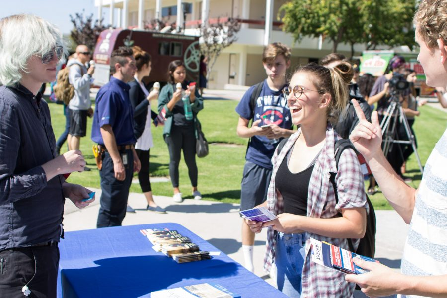 Co-organizer Leslie Kivett quizzes students Chelsea Crall, 19, right, and Conrad Aetlin, far right, 19, an on the First Amendment to the U.S. Constitution during Constitution Day in the quad at Moorpark College, Sept. 15. The event served to help students understand the political climate around the college.