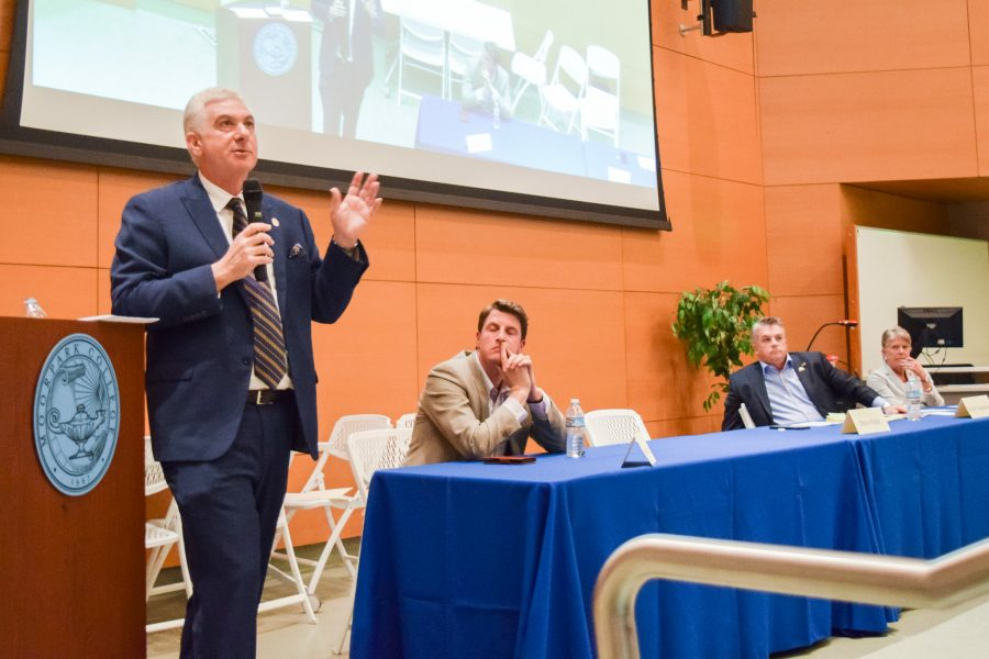 Steve Fazio, running for California State Senate, District 27, speaks as his opponent, Henry Stern listens, along with House Candidates Rafael Dagnesses and Julia Brownley during Moorpark College's Candidate Forum.