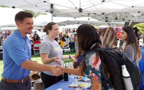 Students talk to representatives from UCLA at last year's transfer day event. UCLA will be on hand as one of the 51 universities being showcased.  (Cole Carlson / Student Voice)