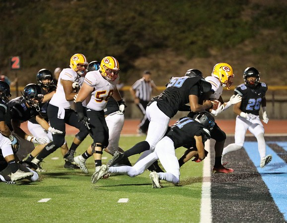 Moorpark Raiders players dragged over the goal line as Saddleback plunges in for a score Photo credit: Angel Ziese