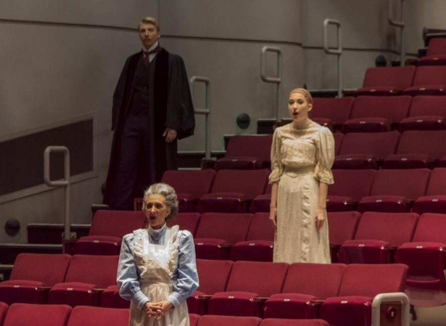Cast members in costume did vocal warm-ups before the dress rehearsal during tech week. Photo credit: Shariliz Poveda