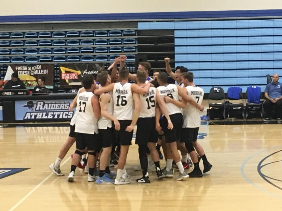 The Moorpark College men's volleyball team celebrate as a unit during the annual alumni volleyball game. Photo credit: Danny Stipanovich
