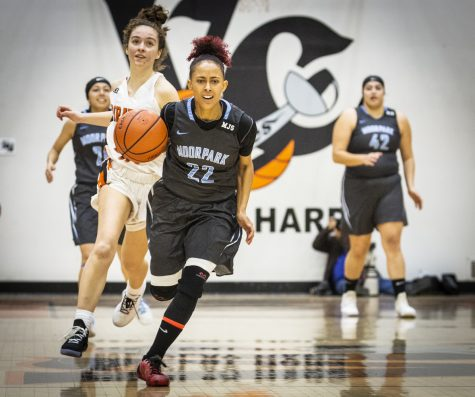 Freshman Breanna Calhoun speeds downcourt during Moorpark College's game against Ventura College on Friday, Feb. 22, in the Ventura College gym. Calhoun concluded the game with 23 points and 8 assists, helping her team claim the win. Photo credit: Evan Reinhardt