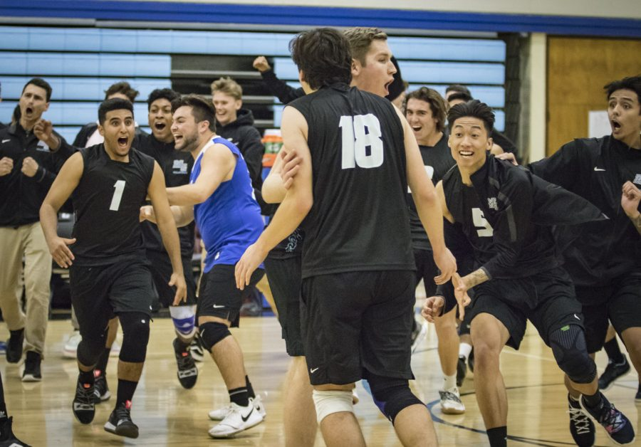 Freshman Setter Steven Weese, 18, is rushed by the rest of the Moorpark men's volleyball team after hitting the game winning kill against Santa Barbara City College, on Wednesday, Feb. 27. Moorpark ended the night victoriously, after winning the fifth set 18-16. Photo credit: Evan Reinhardt