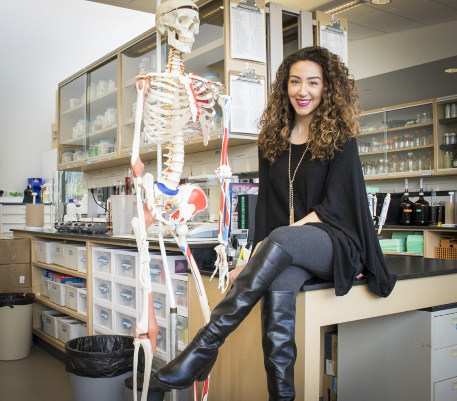 Professor Melia Tabbakhian poses for a portrait next to her teaching skeleton in the Health Sciences Building on Thursday, March 7. Tabbakhian will be giving her informative speech about Familial Mediterranean Fever on March 18. Photo credit: Evan Reinhardt