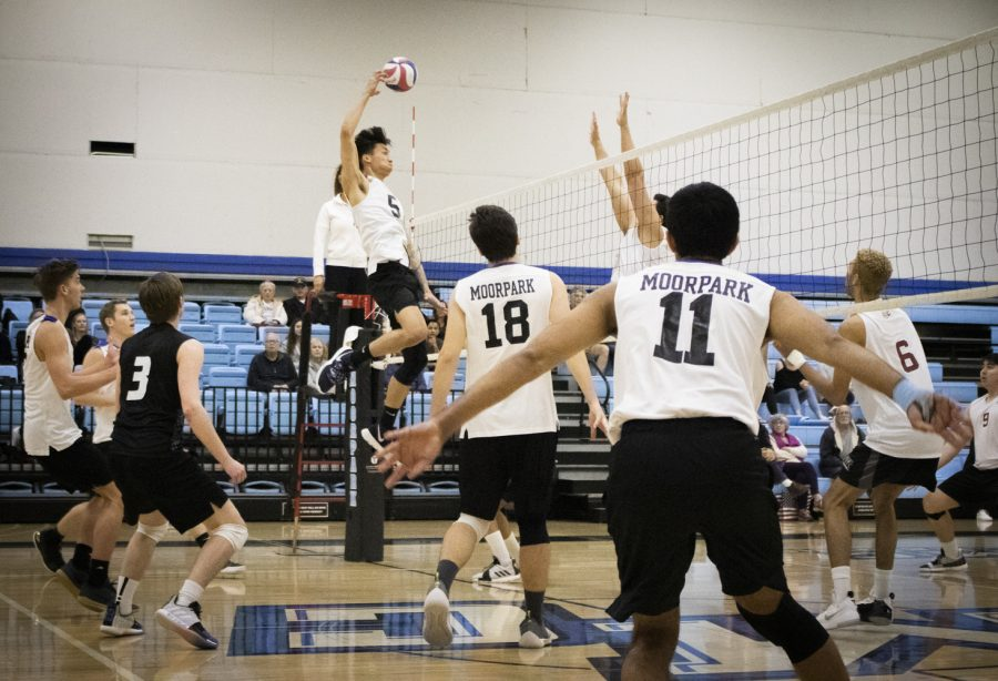 Freshman middle blocker Brandon Dela Fuente, 5, meets the set from Steven Weese, 18, against the Antelope Valley Marauders on Friday, March 8 in the Moorpark College gym. The Raiders swept the Marauders in three sets. Photo credit: Evan Reinhardt