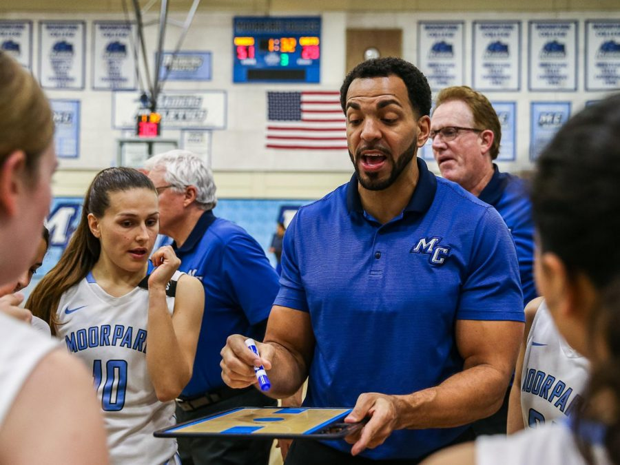 Head Coach Kenny Plummer discusses the game plan with his team just prior to the start of the second half of the 2nd round of the CCCAA Southern California Regional playoffs, held at Moorpark College on Saturday, March 2.  Moorpark defeated Cerritos, 86 to 56. Photo credit: Jace Kessler