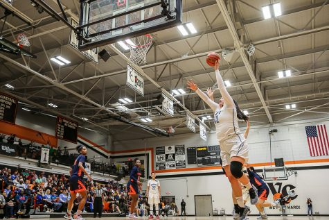 Sophomore Barbara Rangel floats a short jump shot over College of the Sequoias' Hailey Scott during the CCCAA Women's Basketball State Quarterfinals, held at Ventura College on Friday, March 15, 2019.  Rangel led the team with 21 points and 14 rebounds.  Moorpark defeated COS, 66-58.  Photo Credit: Jace Kessler Photo credit: Jace Kessler
