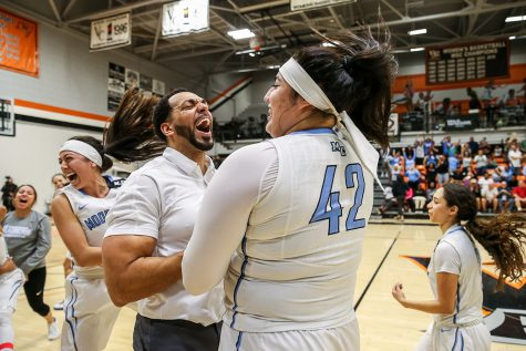 Head Coach Kenny Plummer celebrates with Sophomore Barbara Rangel after Moorpark defeated Merced College, 73 -68, at Ventura College on Saturday, March 16, 2019, advancing to the CCCAA Women's Basketball State Final for the first time in school history.  Photo Credit: Jace Kessler
