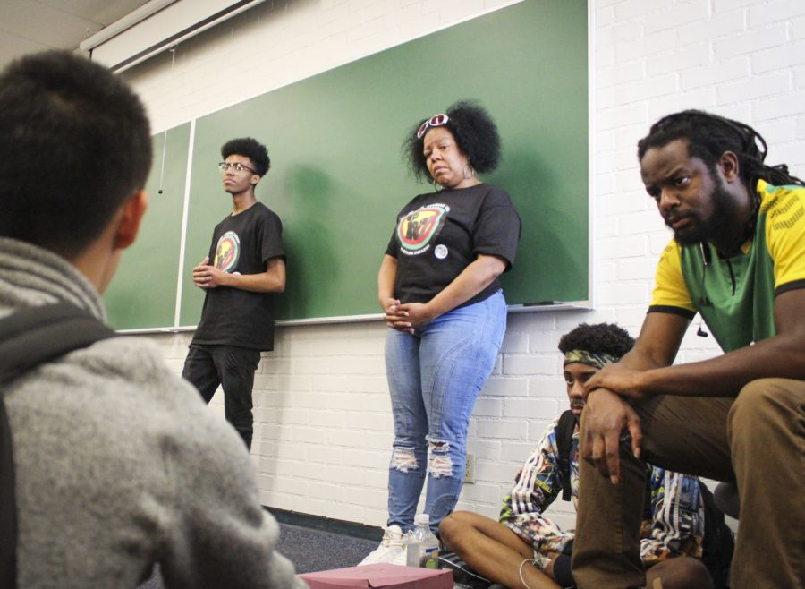Bryson Walker (left), Je'nyce Johnson (center) and Damion Jackson (right) listened to student asking whether it was offensive to be addressed as black or if they preferred African-American.