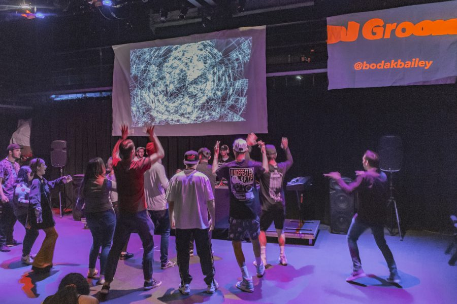 Moorpark College students dance to Bailey Dodson's performance during the DJ showcase in the Black Box Theater on Saturday, April 6. Many students attended in support of DJ Groove. Photo credit: Isabel Simpson