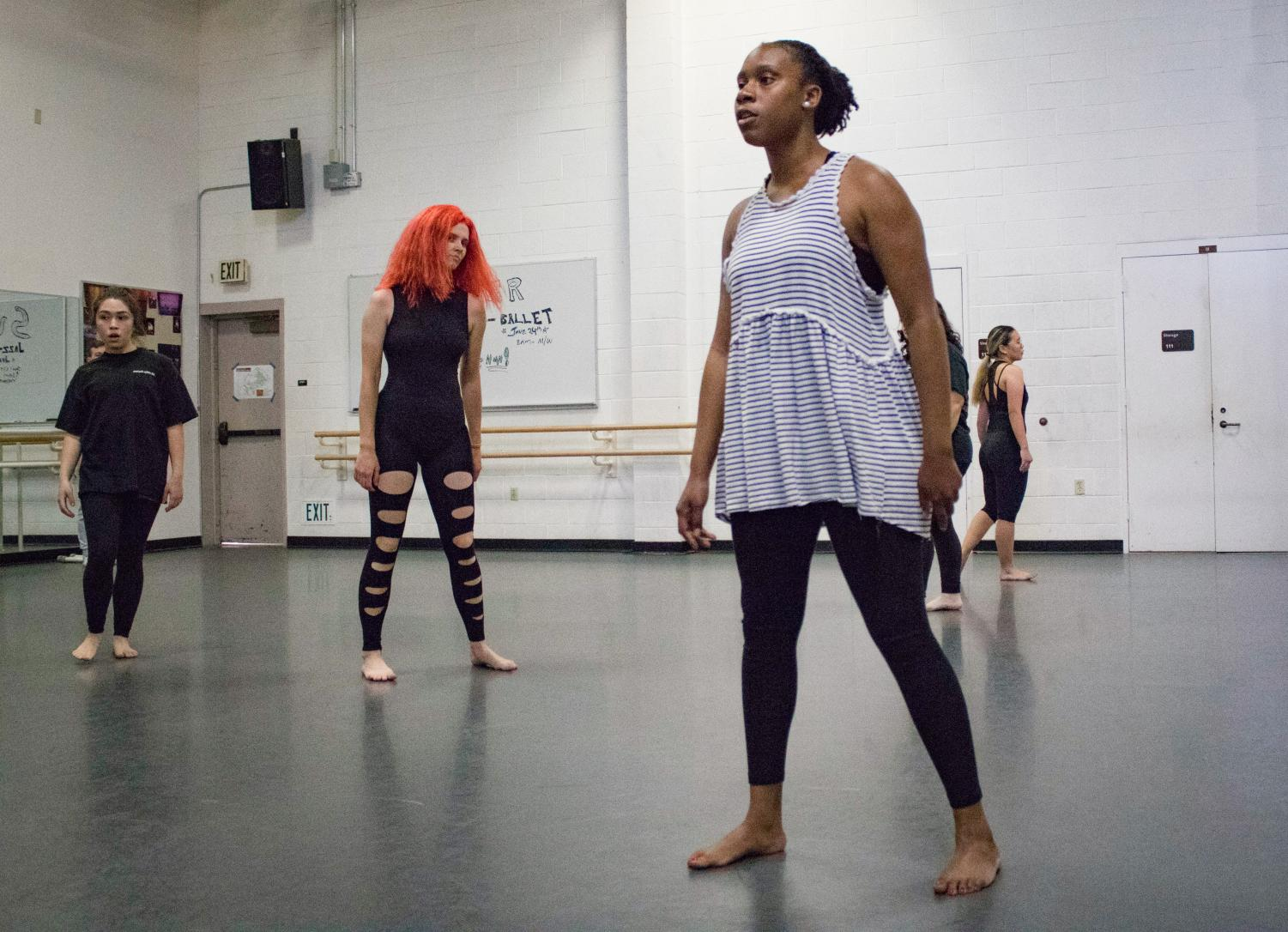 Shandria Blackmon, 27, stands ready to make the next move during Robert Salas's modern dance class last week. The class practices their eerie dance piece, which the dancers call