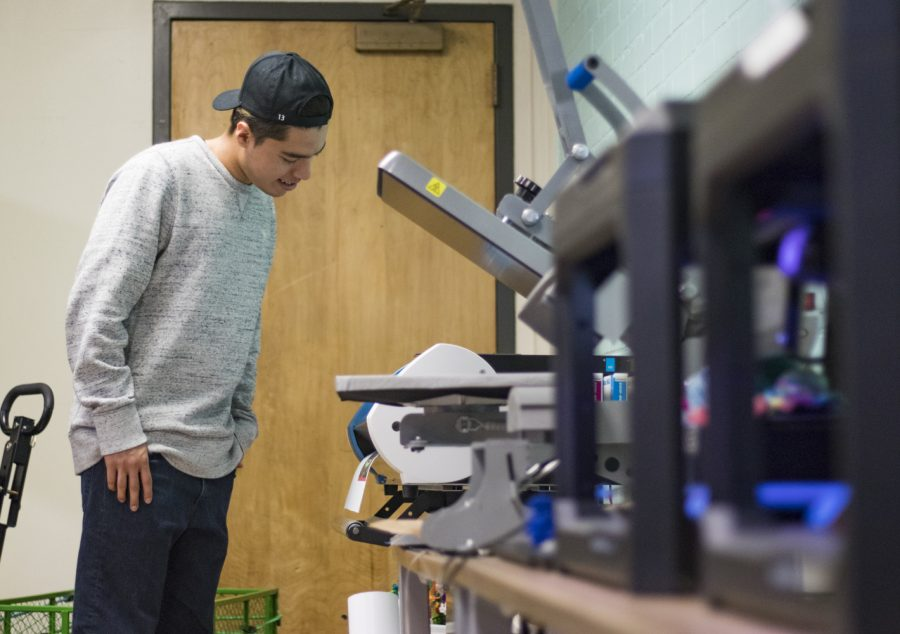 Harrison Leon-Diaz, 20, a business student at Moorpark College, creates art to be pressed onto a t-shirt in the maker Space on Monday, April 29. The Maker Space, located in the Campus Center grants student access to various technologies, along with knowledgable student workers to assist visitors. Photo credit: Evan Reinhardt