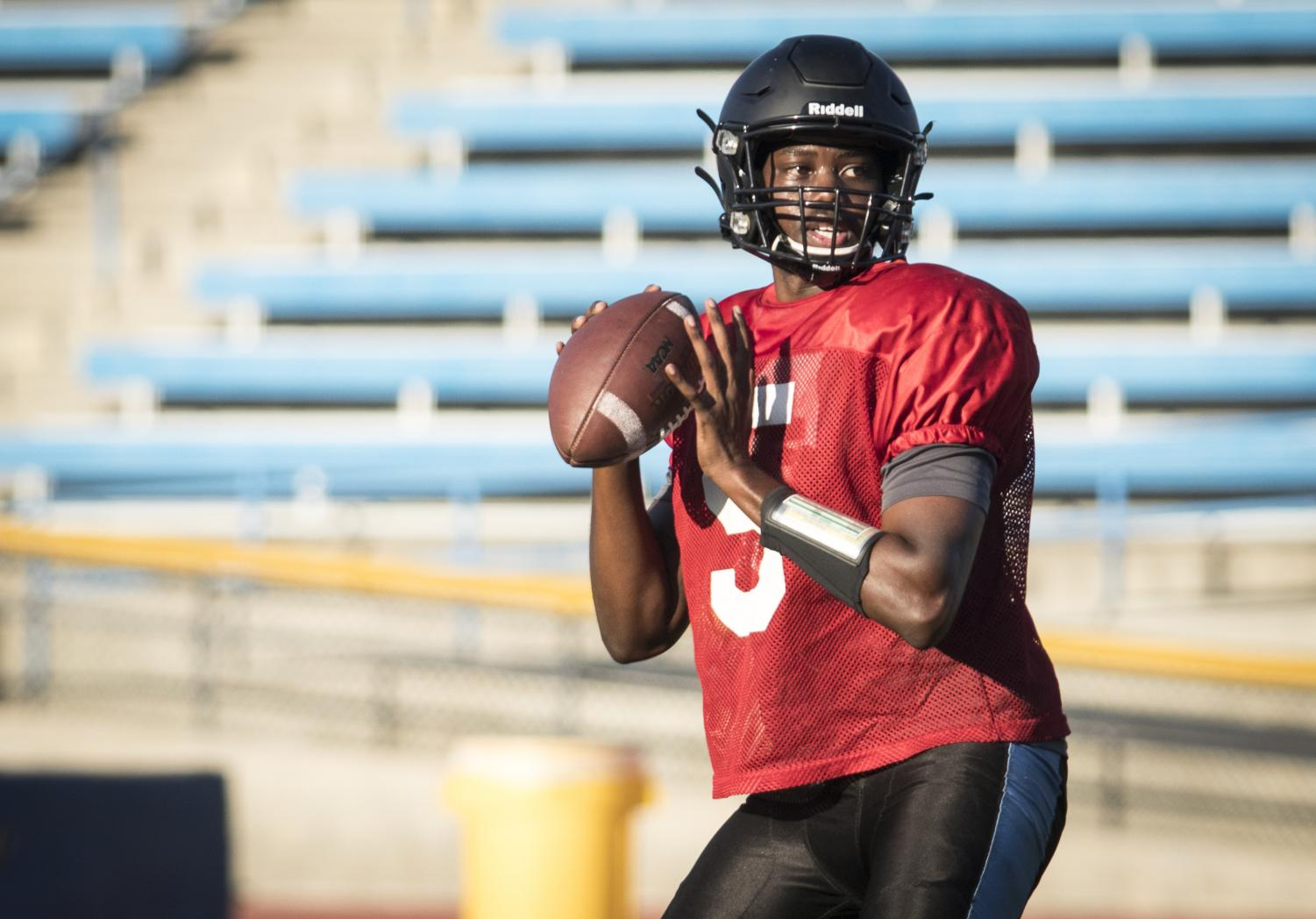 Vincent James prepares for a pass during Moorpark Raider football practice on Tuesday, Aug. 20, at Moorpark College. James is a leader in the team's search for this season's quarterback. Photo credit: Evan Reinhardt