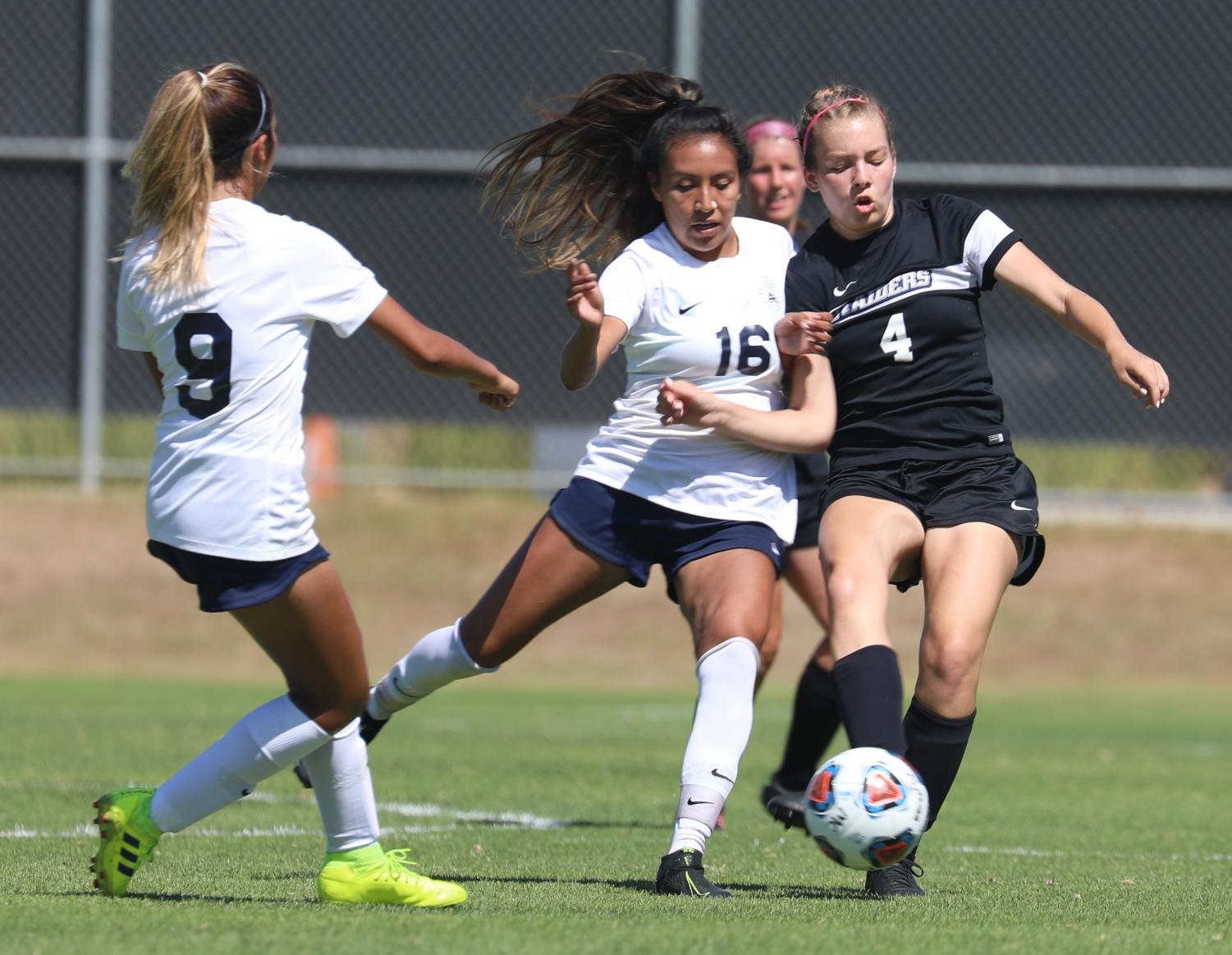 Monica Bernardino competes with Moorpark player, sophomore Megan Chandler during the home game against El Camino College on Friday, Sept. 13. Photo credit: Ryan Bough