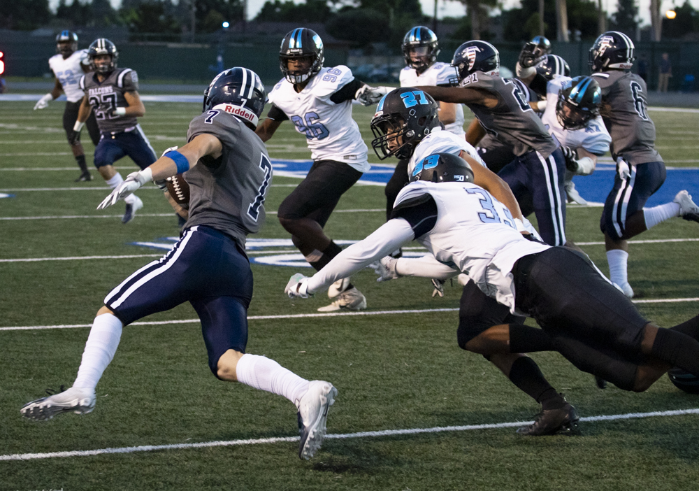 Falcon Wide Receiver Jovohn Tucker, 7, escapes Raider defenders during Moorpark's game against Cerritos College in Cerritos, Calif. on Saturday, Sept. 14. Moorpark struggled on defense, missing several tackles and executing no sacks. Photo credit: Evan Reinhardt