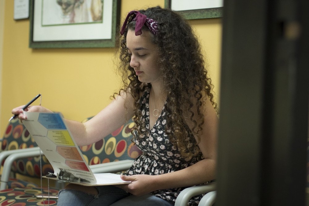 Alia Leavitt, an education major, fills out appointment forms at the Student Health Center, on Tuesday, Sept. 10. Photo credit: Evan Reinhardt