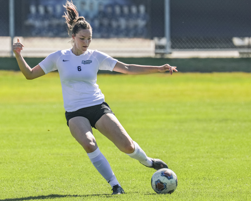Amanda McMurry, 6, kicks the ball downfield to her teammates during the match against Reedly College on Saturday, Aug 31. Photo credit: Ryan Bough