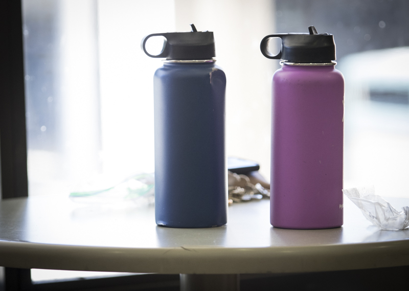 Two+reusable+bottles+sit+on+a+table+in+the+campus+cafeteria%2C+on+Thursday+Aug.+29.+An+increasing+number+of+students+on+campus+use+Hydro+Flasks%2C++S%27well+bottles+and+Yeti+canteens+to+reduce+their+plastic+usage.+Photo+credit%3A+Evan+Reinhardt