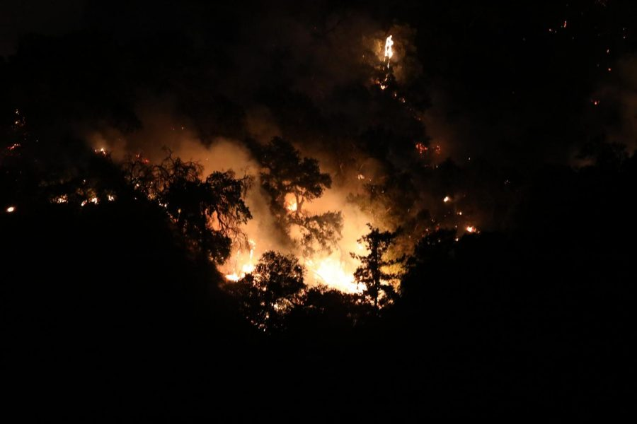 The+Saddle+Ridge+fire+burns+into+the+early+morning+hours+on+Saturday%2C+Oct.+12%2C+in+Sylmar.+The+Fire+burned+a+total+of+8%2C391+acres+and+destroyed+19+structures.