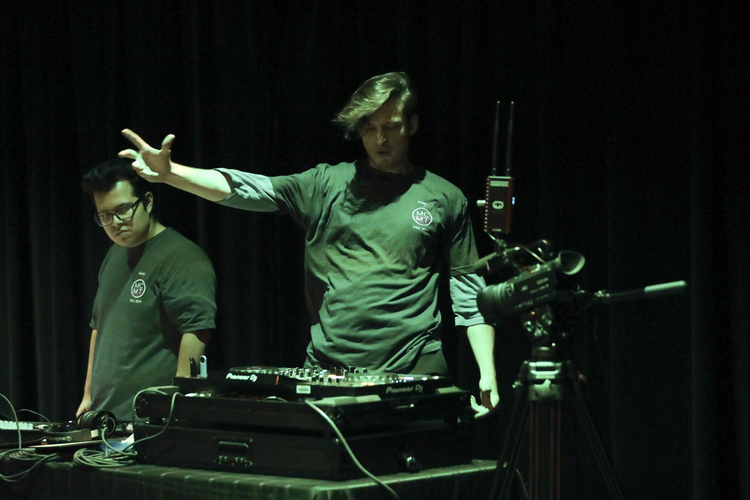 Lysander Hernandez (left) watches as Preston Teel (right) reaches out to the crowd during his performance at the Student DJ Showcase on Friday, Oct. 25, at Moorpark College. Photo credit: Ryan Bough