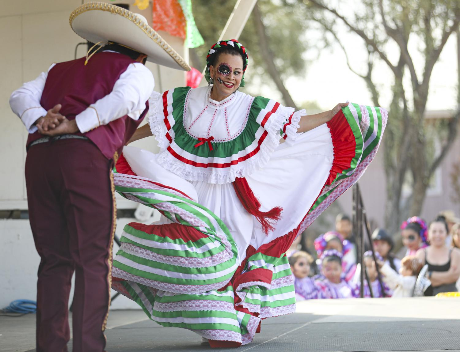 Carmen Gil dances with her husband Juan Gil during a charismatic folk dance at the Dia de los Muertos Festival in Simi Valley on Sunday, Oct. 27. Photo credit: Ryan Bough