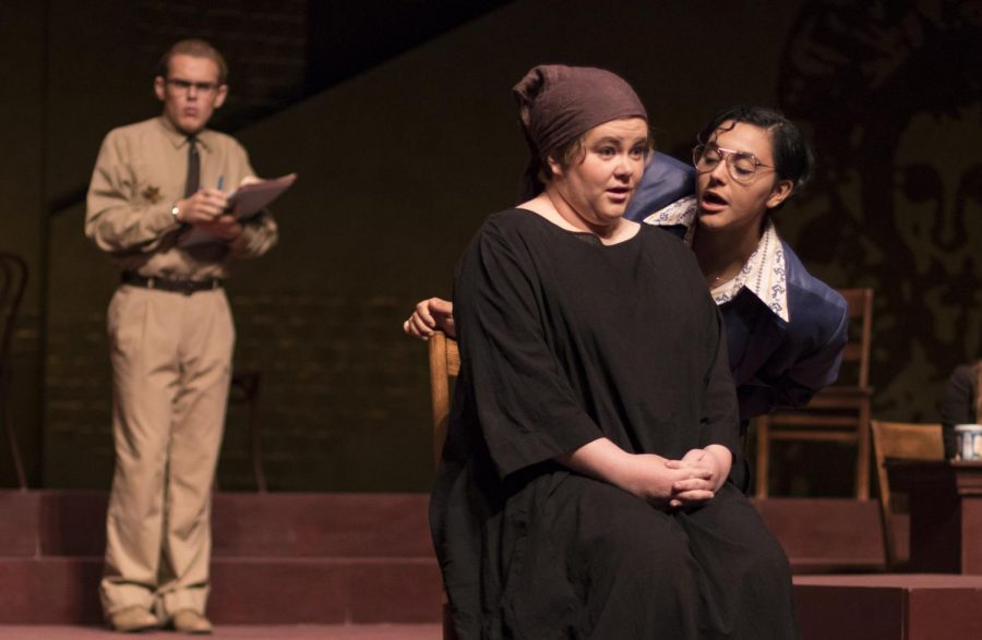 Megan Ragone, as Henrietta Iscariot, is questioned by Levi Flores, as Yusef El-Fayoumy, during the student showing of