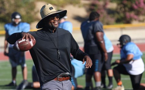 Nate Turner, the wide receiver coach and former NFL player, passes the ball back and forth to his group during football practice on Aug. 20, at Moorpark College. Photo credit: Ryan Bough