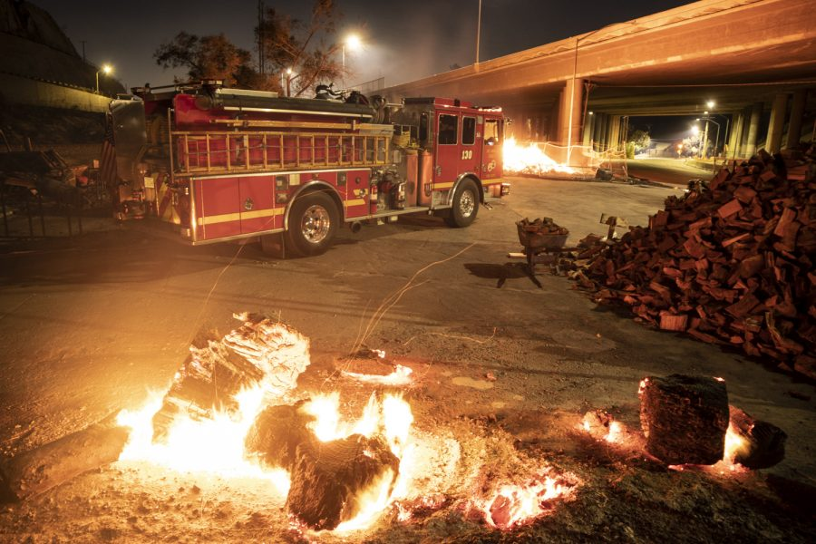 Fire+trucks+await+the+burn+of+a+controlled+fire+in+a+fire+wood+seller%27s+property+early+Saturday+morning%2C+Oct.+12%2C+in+Sylmar%2C+Calif.