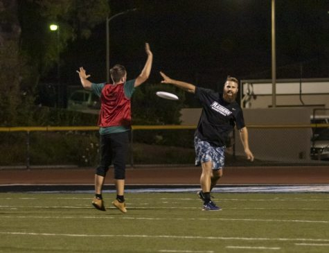 Kyle Innocenti attempts to block a pass from Brock Cushings, Moorpark faculty member, during the game of ultimate frisbee on Thursday, Oct. 3. The FLeX program hosted the game at Griffin Stadium. Photo credit: Evan Reinhardt