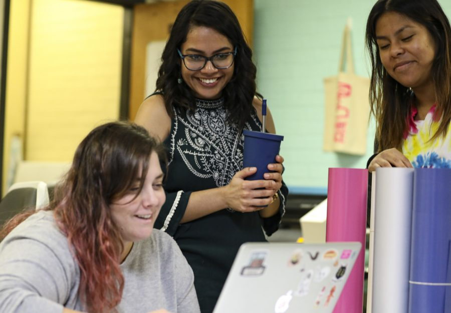 The director of the Makerspace Clare Sadnik, left, works with student success coach and 540 initiatives lead Karla Montenegro Gonzalez, middle, and Junior Arisay Diaz, right, on the logo for the tote bags on Oct. 17 in the Maker Space at Moorpark College. Photo credit: Ryan Bough