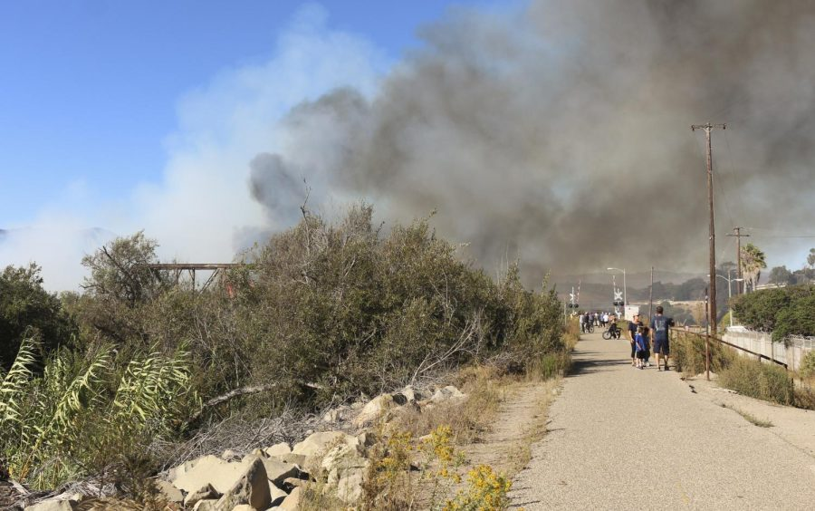 Smoke+rises+from+a+dry+riverbed+in+Ventura%2C+CA+on+Friday%2C+Oct.+25%2C+2019.+Authorities+believe+it+was+started+by+an+illegal+campfire.