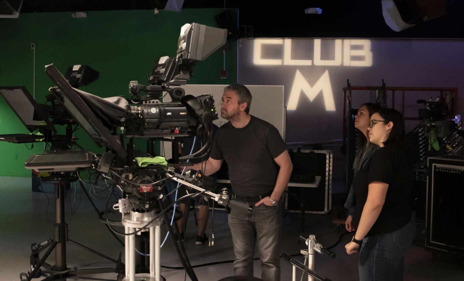 Professor Michael Grimes (left), Club M producer Savanna Cory (middle), and Moorpark College FTVM major Eloise Schmitt (right) set up for a practice run-through for Club M on Tuesday, Nov. 19. Photo credit: Dominic D'Amico
