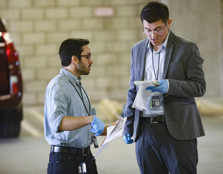Chris Korea, left, compares notes with Branden Padilla, right, during the mock crime scene at Moorpark College on Tuesday, Nov. 5. Both Korea and Padilla were detectives working to solve the crime. Photo credit: Ryan Bough