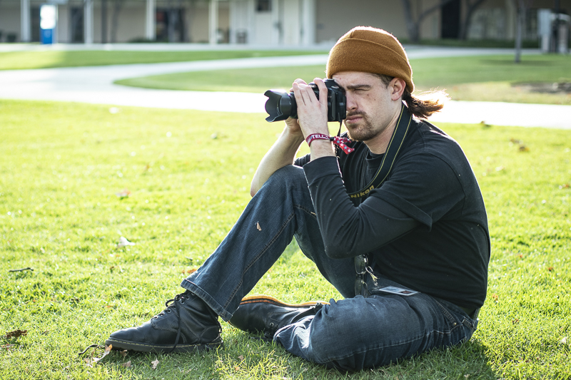 Keir+Kloss%2C+Moorpark+student%2C+lines+up+a+shot+of+other+fellow+students+on+Thursday%2C+Nov.+14+in+the+quad.+Kloss+said+he+would+like+to+see+more+honest+portrayals+of+the+average+Moorpark+College+student.+Photo+credit%3A+Evan+Reinhardt