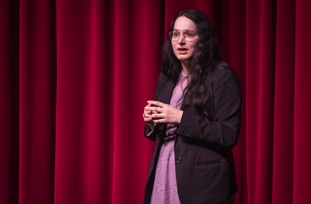 Nicole Castro delivers her speech about transgender individuals in organized sports during the Forensics Showcase on Tuesday, Dec. 10, in the Performing Arts Center. The style of speech included jokes and witty word play to deliver a larger message. Photo credit: Evan Reinhardt