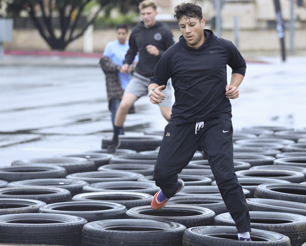 Rodrigo Toledo runs through the tires during the 8th annual Xtreme Raider Challenge hosted by the Moorpark College Fitness Specialist Program and the FLeX Club at Moorpark College on Saturday, Dec. 7. Photo credit: Ryan Bough