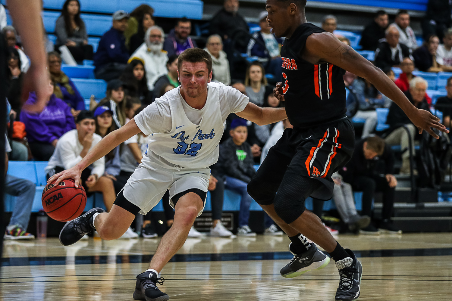 Colton Hage works his way around Ventura College's Dayveon Bates during their conference game at home on Saturday, Jan. 18.  Ventura defeated Moorpark 97-91. Photo credit: Jace Kessler