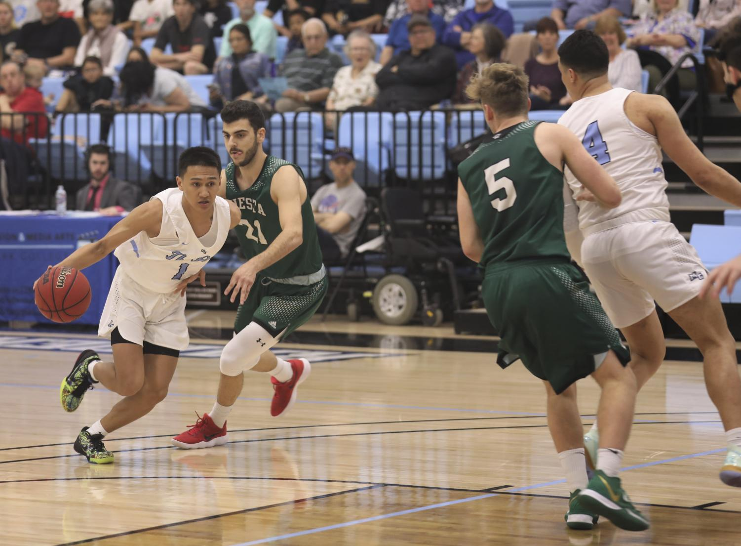 Sophomore guard Ben Guard attempts to break down his defender in their 85-76 victory over Cuesta College on Saturday, Jan. 25 at Moorpark College. Photo credit: Ryan Bough