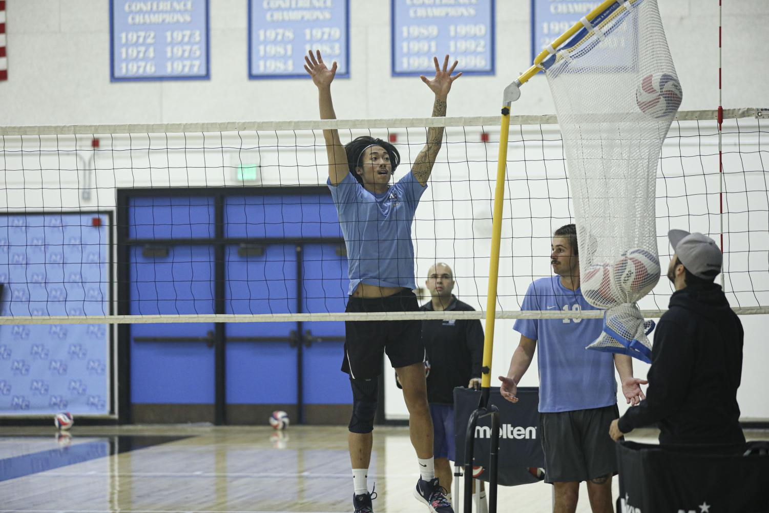Brandon Dela Fuente, a middle for the Moorpark mens volleyball team, practices a blocking drill with his teammates on Tuesday, Jan. 21. at Moorpark College. Photo credit: Ryan Bough