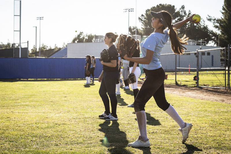 Dee+Villa%2C+along+with+the+rest+of+Moorpark%27s+softball+team%2C+warm+up+their+arms+during+practice+on+Wednesday%2C+Jan.+22%2C+on+the+Raider+softball+field.+Photo+credit%3A+Evan+Reinhardt