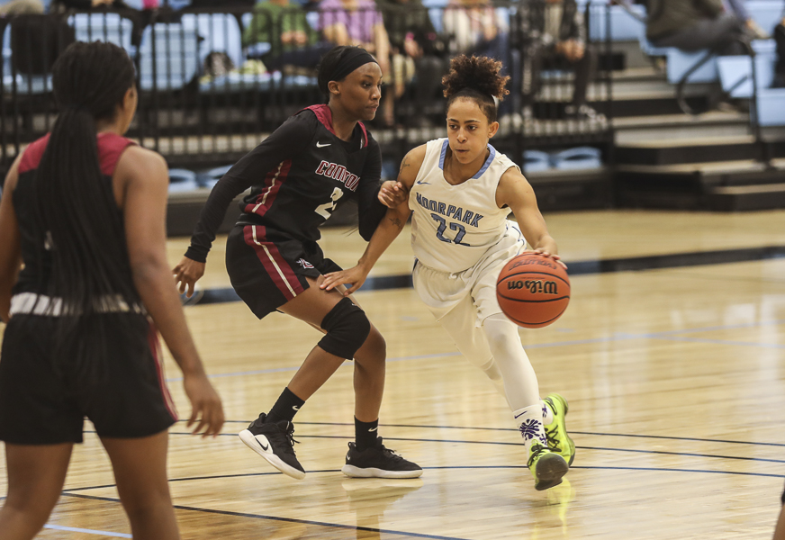Moorpark+Sophomore+guard+Breanna+Calhoun+dribbles+down+the+court+during+the+home+game+against+Compton+College+on+Friday%2C+Jan.+10.+Moorpark+beat+Compton+107-38.+Photo+credit%3A+Ryan+Bough