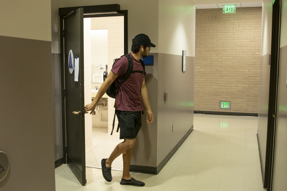 Carter Bell, Moorpark student, leaves one of the gender neutral bathrooms in the AC building, on Thursday, Feb. 13. According to Carter, bathrooms should be a place of privacy and safety, not awkwardness and fear. Photo credit: Evan Reinhardt