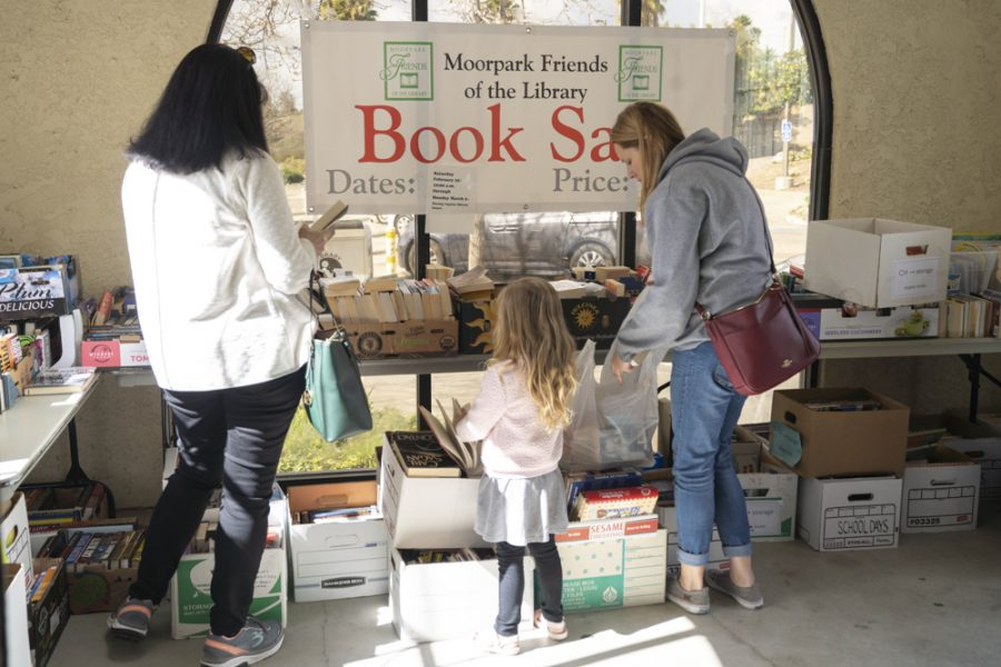Moorpark locals come through the Moorpark Public Library to participate in the book sale on Saturday, Feb. 22. Patrons could fill one bag full of books for $4. Photo credit: Tara Brown